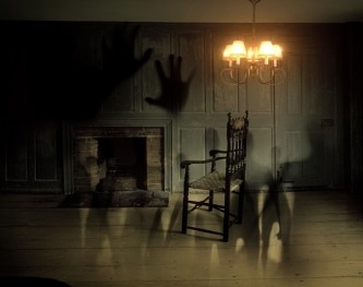 shadows-of-hands-and-humans-in-gloomy-room-USE Photo Credit